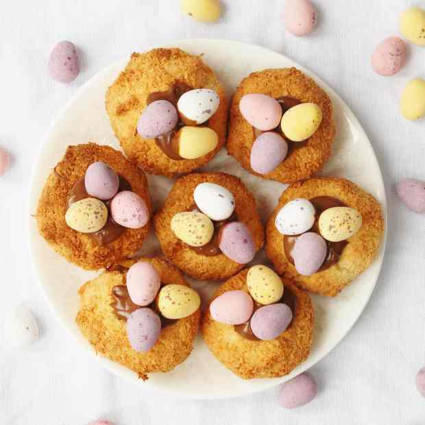 Coconut Macaroons topped with melted chocolate and mini eggs. An easy Easter bake
