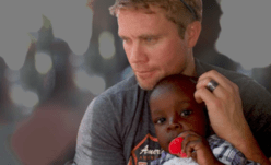 Tim Ballard and child