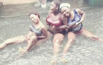 Ladies Swimming in Flooded Area After Heavy Rail Fall