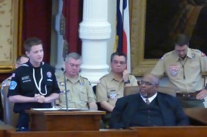 John Shepherd delivering the report to state address.