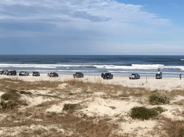 Cars on the beach in January at New Smyrna Beach, Florida