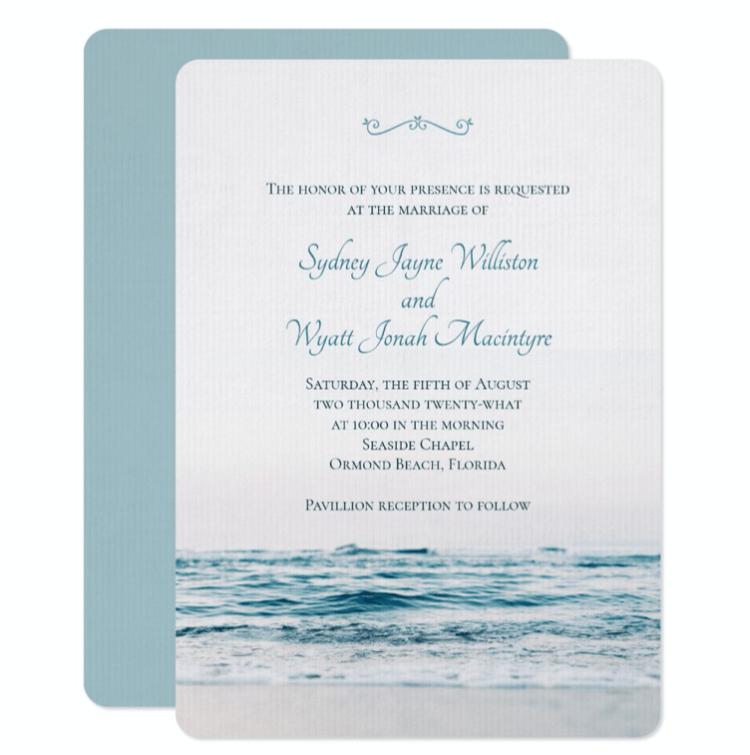 Blue water simple wedding invitation template in white with ocean image at the bottom and solid blue reverse.