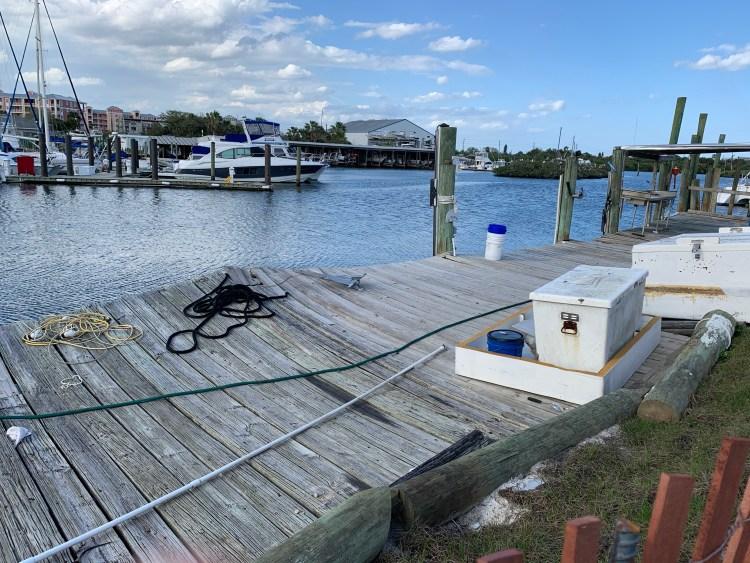 New Smyrna Beach marina deck damage from hurricanes