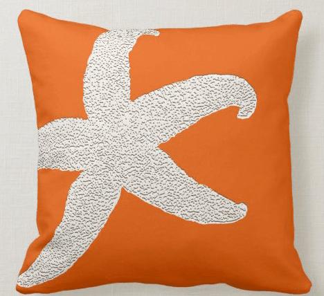 Orange pillow big starfish graphic
