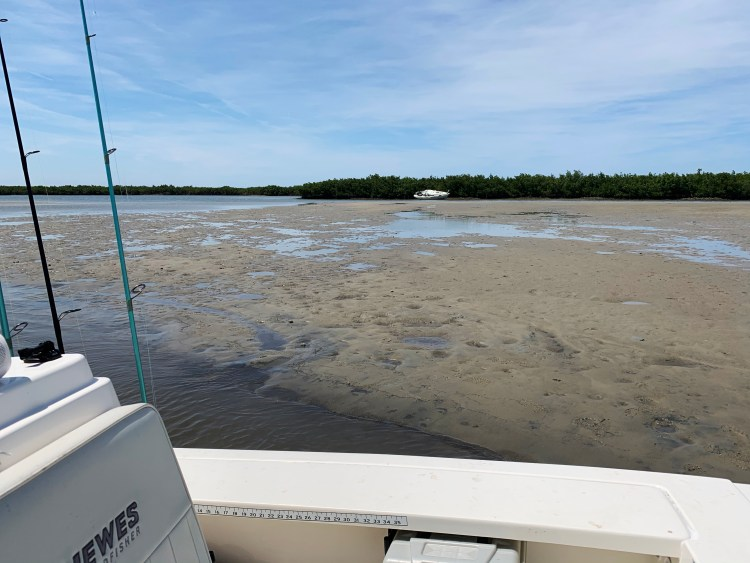 Three Sisters mud island docked Hewes boat shipwreck low tide