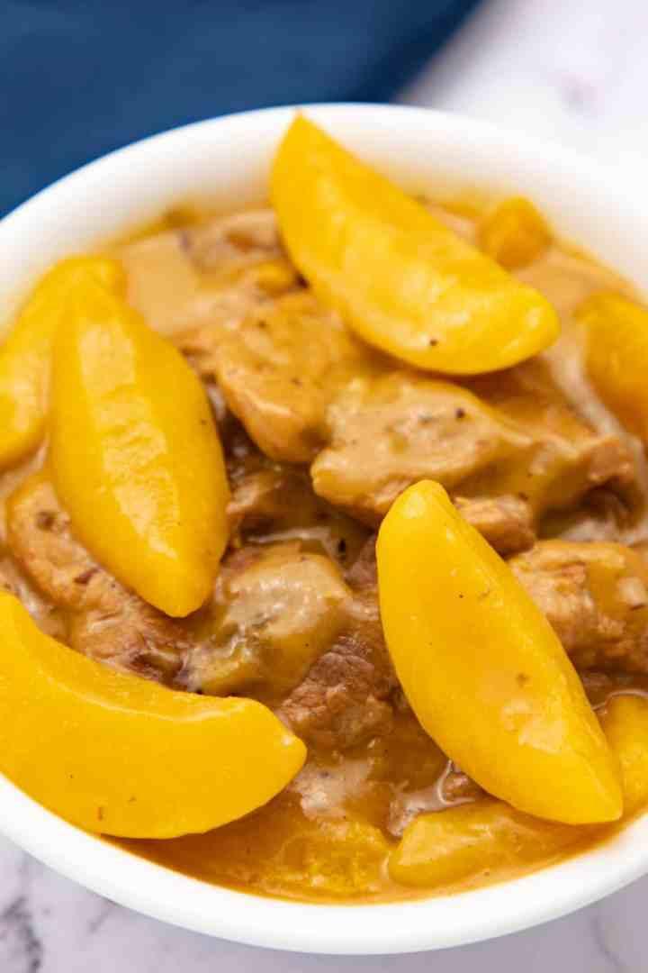 Creamy Peaches and Pork in a bowl