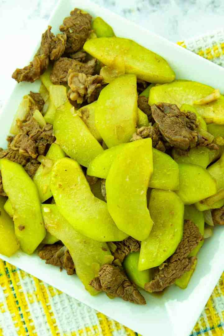 sautéed beef and chayote in a white plate