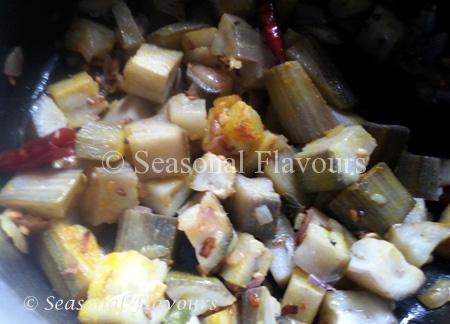 Add boiled banana pieces to Aratikaya Kobbari Kura Recipe