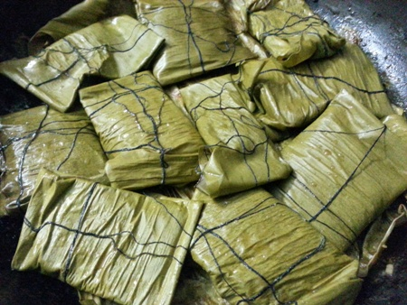 Fish cooked in banana leaves Bengali style recipe