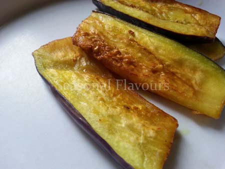 Fry brinjal slices and remove for Bengali eggplant curry recipe