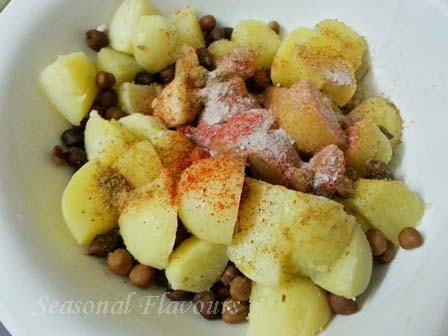 Add chaat seasoning for potato and chickpeas recipe