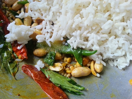 Add rice to Pulihora seasoning for Pulihora Andhra Recipe