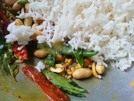 Add rice to Pulihora seasoning for Pulihora Andhra Recipe