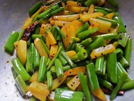 cook onion stalks for Peyajkoli Aloo Bhaja Recipe