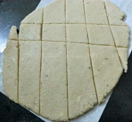mark lines on rolled cashew dough for cashewnut burfi recipe