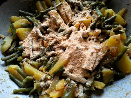 Sprinkle roasted chana powder for barbati aloo fry recipe