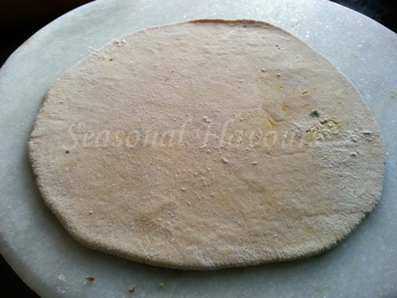 Roll out sattu flour paratha