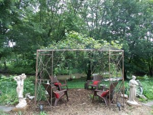 Grape Arbor with seating and a view.