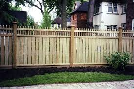 Solid wood privacy fence with defensive pickets on top.
