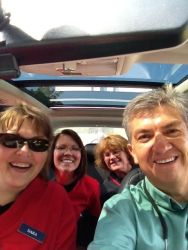 Dara, Anastasia, Nellie, Norman driving in the car. We are on a mission!!!!