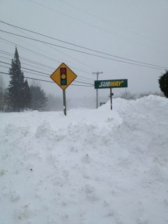 Subway sign in Camden Maine. Tons of snow from blizzard, Nemo.