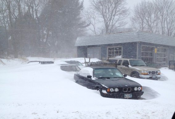 The cars are burried in the snow.