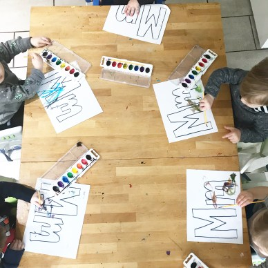 toddlers painting letters