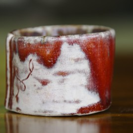 Emily's oval ring pot (red/gold with swirl)