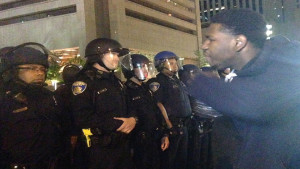 A young man in Baltimore yells his frustrations at police in riot gear. Photo/Hazel Trice Edney.
