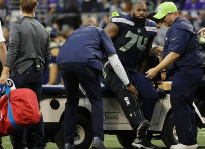 Seahawks left tackle George Fant carted off the field