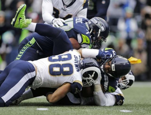 Seahawks QB Russell Wilson sacked 7 times in the game against the LA Rams in CenturyLink Field (AP Photo/John Froschauer)