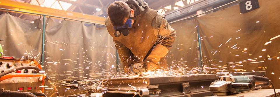 sparks fly grinding metal