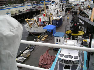 Dock with multiple boats waiting for repairs