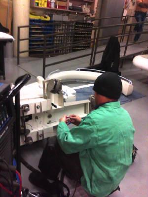 Employer fixing medical equipment