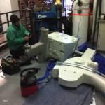 Medical Metal Contractor working on equipment