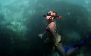 Renee Blundon in the Blue Lagoon on Mafia Island 1680 x 1050