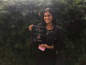 LMU student holding award