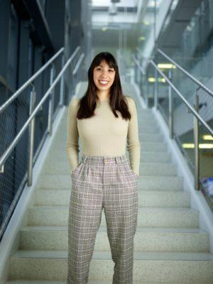 Senior Biology Major Jacquelyn Galvez poses on a staircase