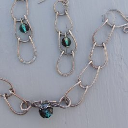 Silver bracelet and earring set