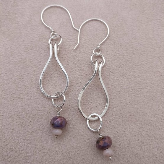 Pair of silver teardrop earrings with pink and purple beads