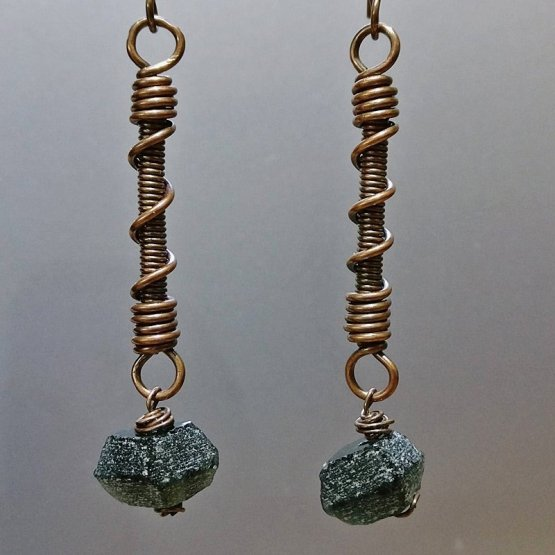 Long coiled opper earrings with black recycled glass beads