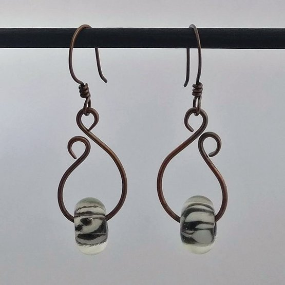 image of teardrop earrings with black and white lampwork beads