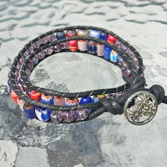 Black waxed cotton cord bracelet with red and blue cane beads