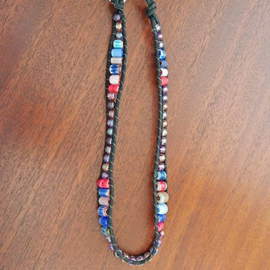 Image of black waxed cotton cord bracelet with cane beads opened up