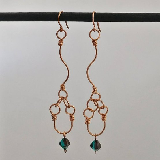 image of long copper earrings with emerald swarovski beads