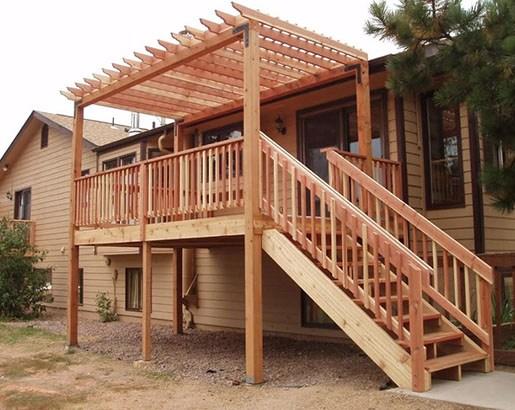 35 Unique Deck Railing Ideas Sebring Design Build   Wood Deck Stair Railing   Step   4X4 Deck   Interior   Underneath Bracket   Gray Deck Black