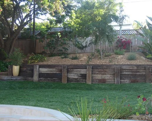 wood retaining wall ideas for sloped