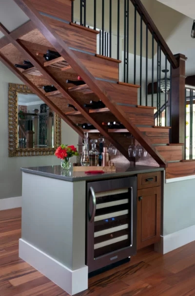37 Under Stair Storage Design Ideas Sebring Design Build | Kitchen Under Stairs Design | Stair Case | Wet Bar | Basement Stairs | Living Room | Basement Kitchenette