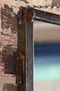 Industrial metal frame wall mirror