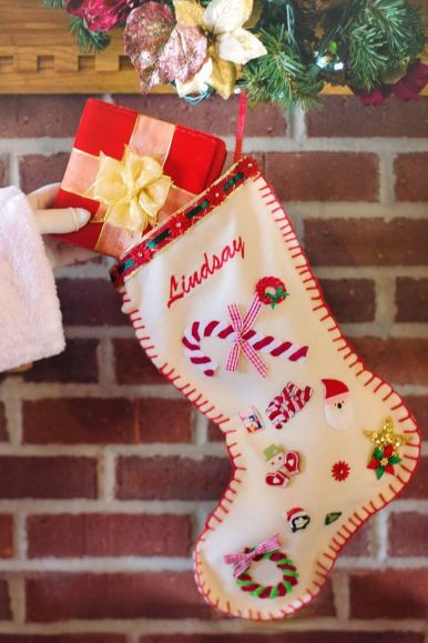 "White Christmas stocking that says ""Lindsey"""